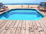 Corasiida Guest House – Pool und Meer
