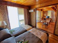 Beach Suite mit Twinbett und Wohnraum
