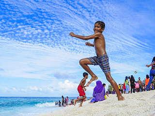 Am Korallenstrand – Tauchreisen Malediven